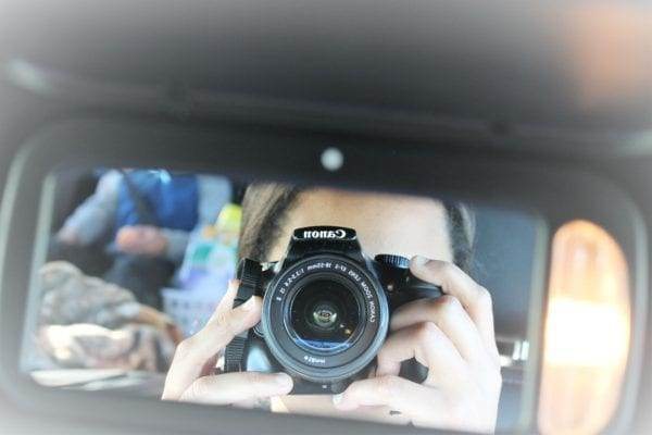 Cherelle German taking photo of herself on family road trip