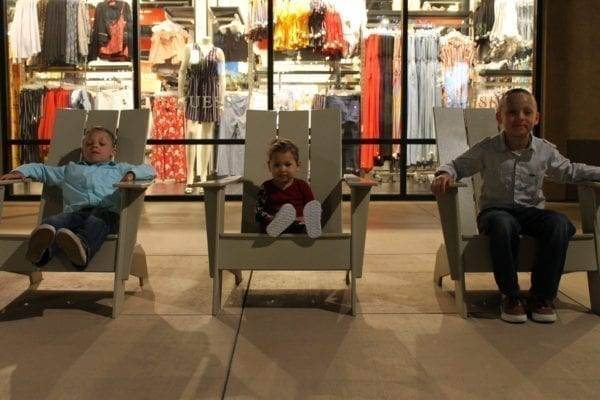 Posing in chairs at Outlet stores in Palm Springs, California