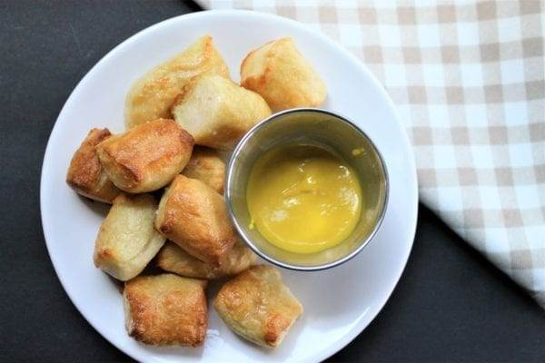 Easy Homemade pretzel bites made without yeast on a white plate with mustard dipping sauce