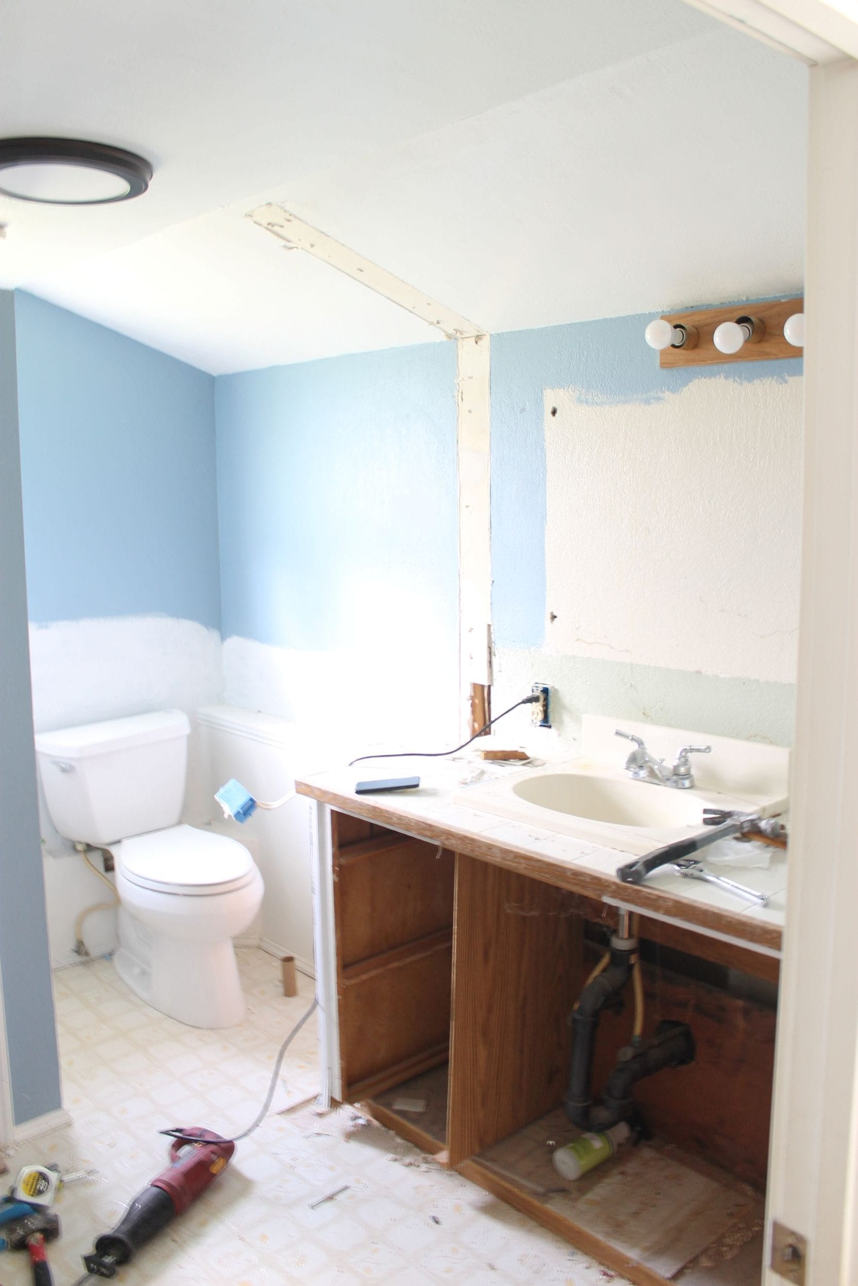 Small bathroom remodel process. Removing the mirror and vanity