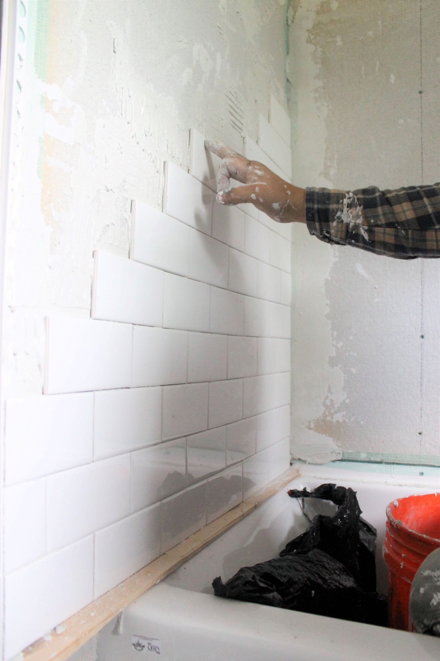 tiling our small bathroom shower wall surround with subway tile