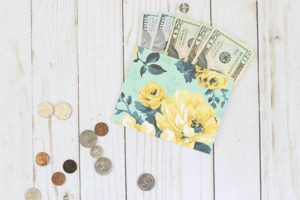 money in floral envelope and coins