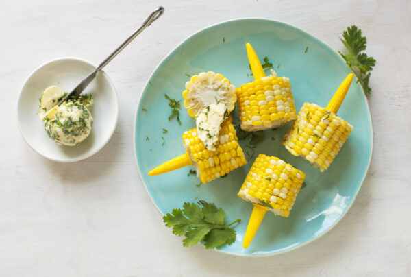 Cooked corn with herb butter