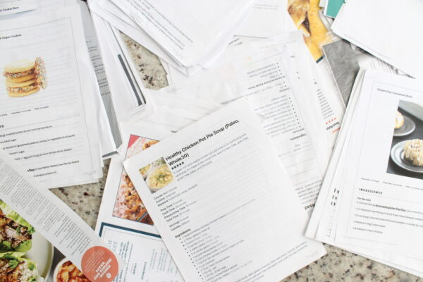 piles of printed out recipes